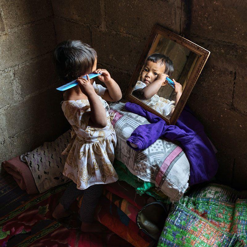 Khasi Girl-Child Brushes Hair