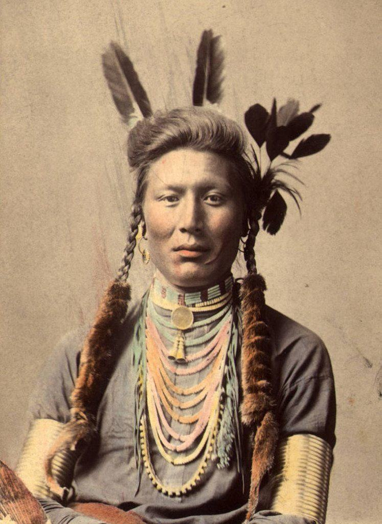 Rosa lame dog, a sioux native american girl, standing at the entrance to a tipi on the great plains