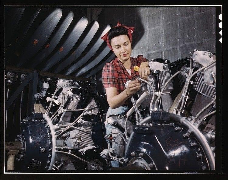 women of WWII airplane motor