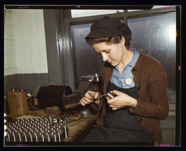 women of wwII filing metal parts