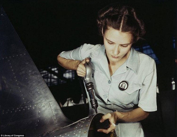 Women of WWII riveting aircraft light dress