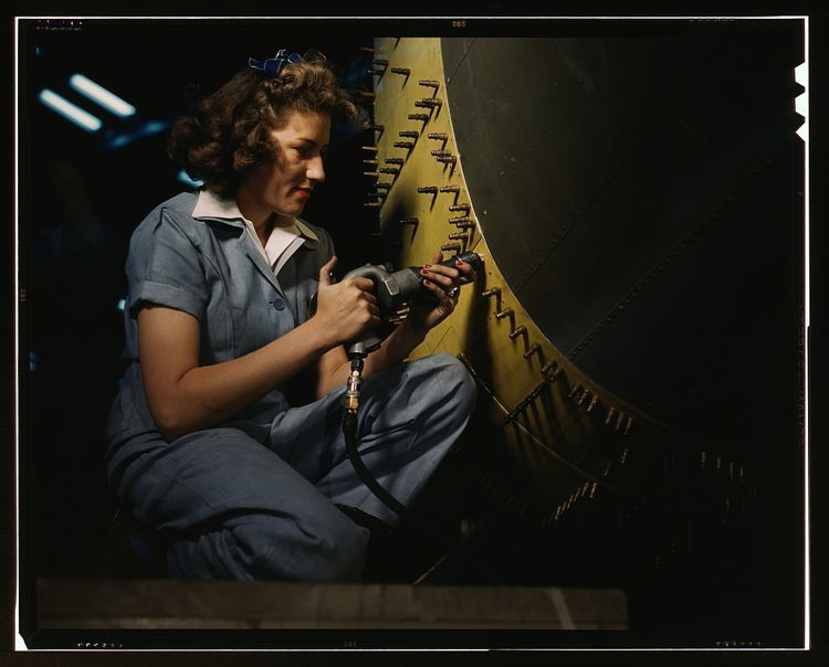 women of WWII riveting bomber