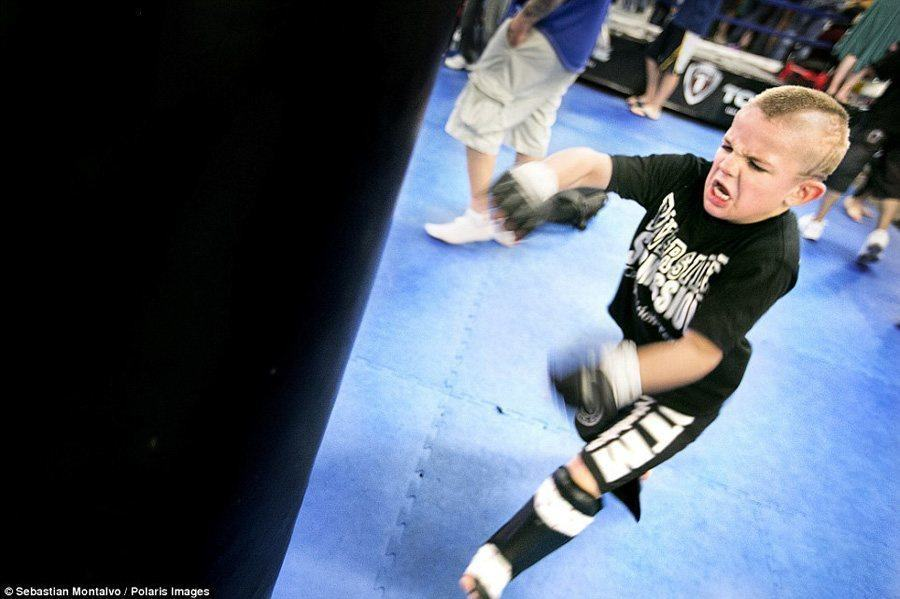 "Dailymail  Mason ""The Beast"" Bramlette training on a heavy bag at the Ultimate Fitness Gym shortly before the 2013 California State Pankration Championships."