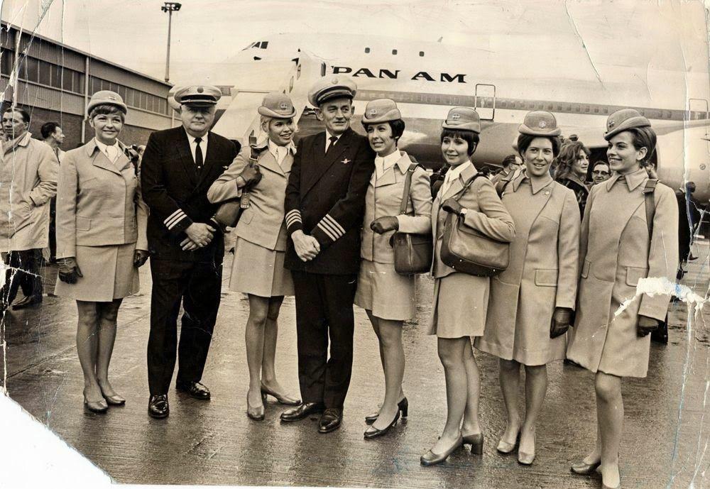 Stewardesses and crew posing air travel