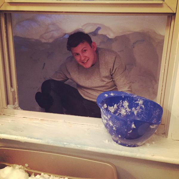 Man tunnels out of his window due to massive snowfall