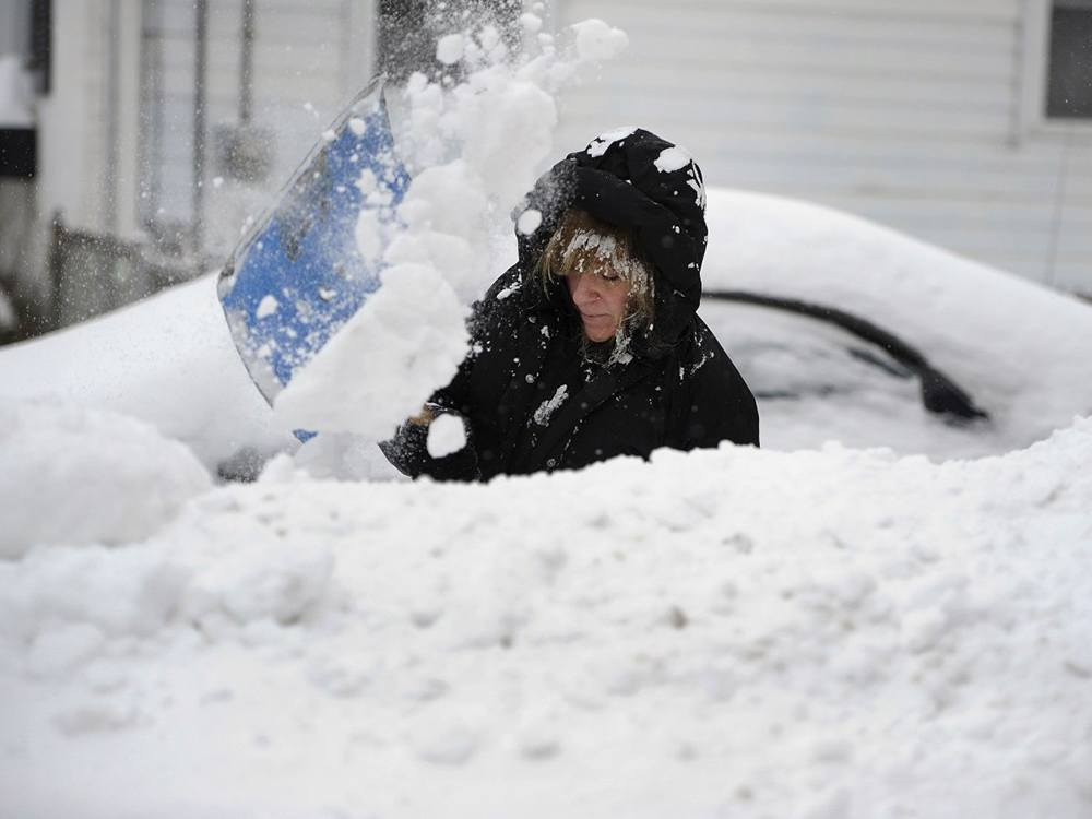 Woman shovels northeast snow