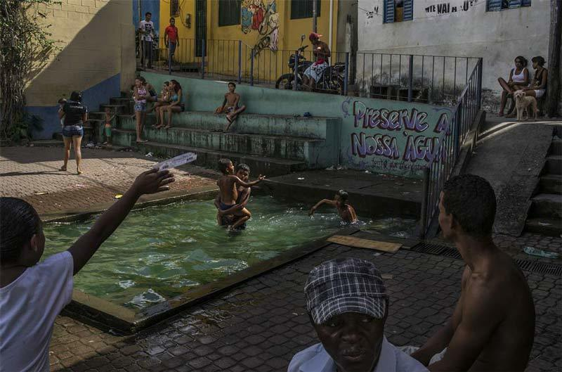 Swimmers at pool during drought in Brazil