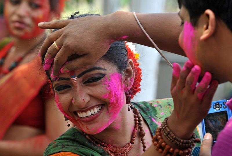 Woman Colors Face for Holi