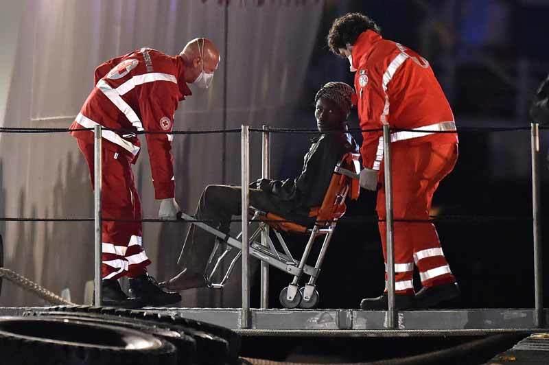 Injured migrant loaded onto ship in Mediterranean