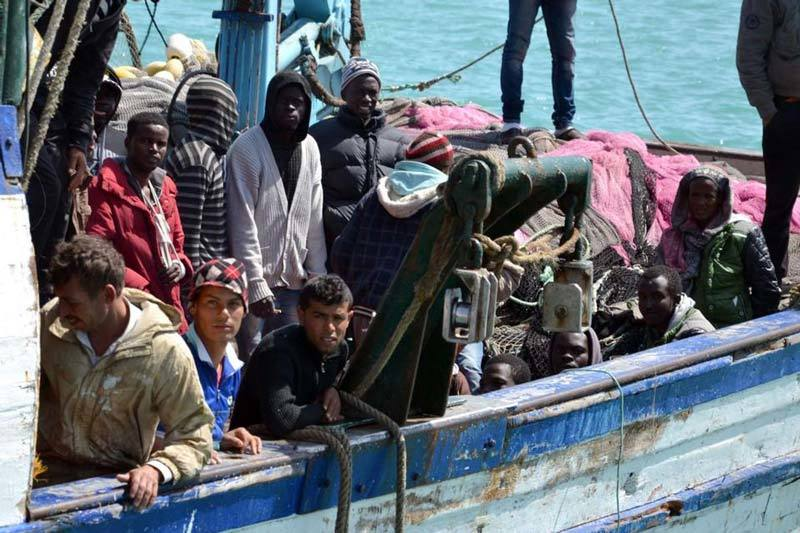 Weary migrants from north Africa make landfall in Tunisia. Source: Boston Globe