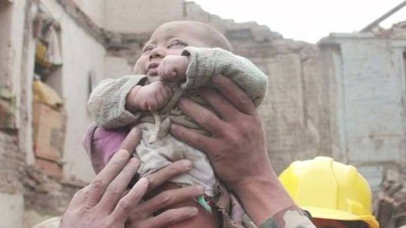Baby rescued from rubble in Nepal