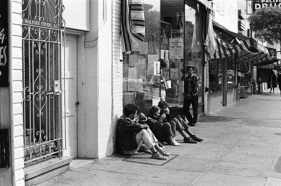 haight ashbury 1967 sidewalk sitting