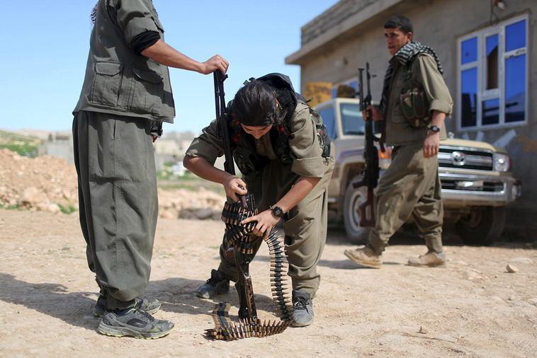 Female ISIS Fighters Adjusting Gun