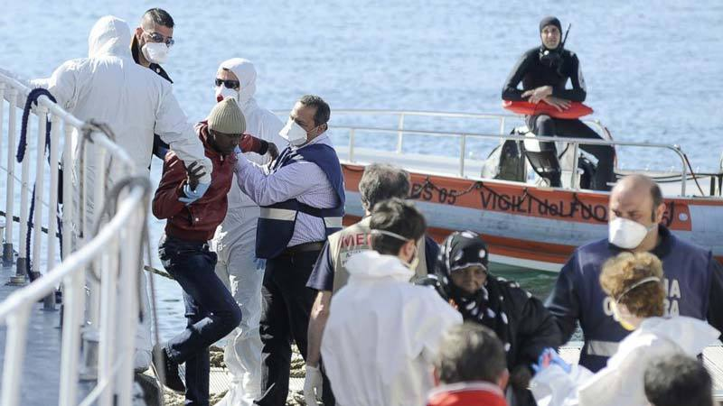 Migrants loaded onto a rescue ship in the Mediterranean