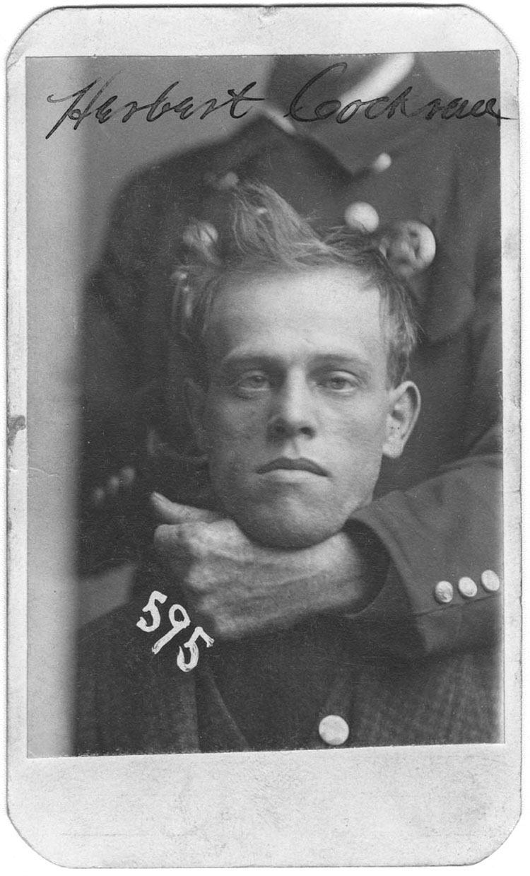 Policeman Holding Herbert Cockran