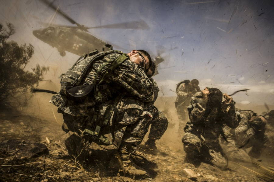Landing Helicopter Crouching Soldiers