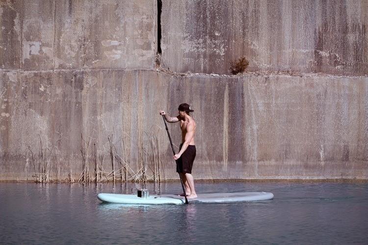 mysterious waterfront women paddleboat