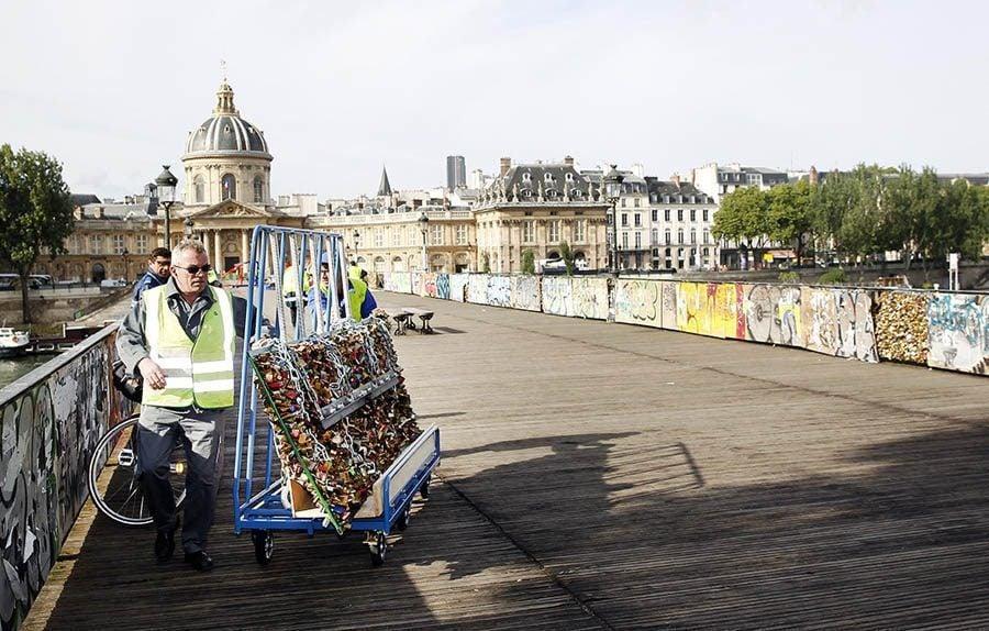 paris love locks wheeling away
