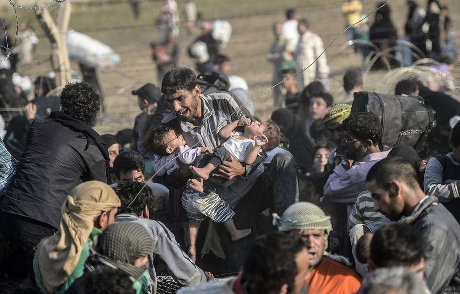 Syrian Refugee Holding Children