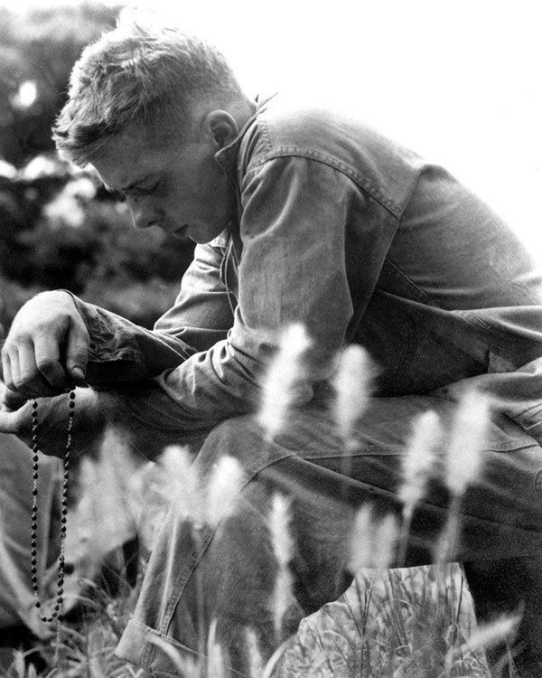 U.S. Soldier Prays During Korean War