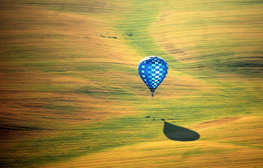 A hot-air balloon flies over the outskirts of Minsk, Belarus as part of the Second Annual Aeronautics Championship. Source: The Atlantic