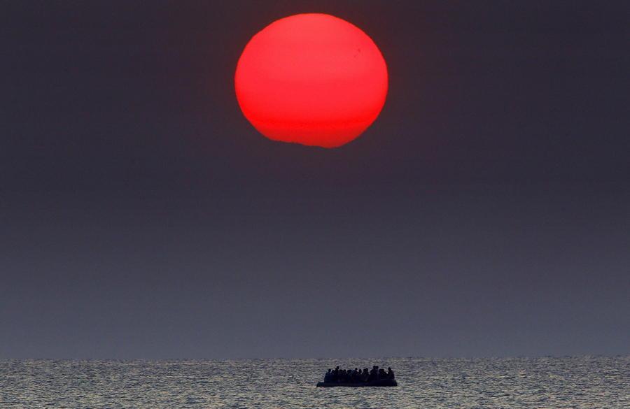 Migrant Boat Red Sun