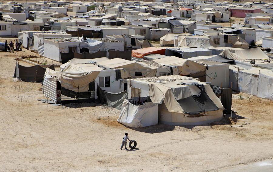 Refugee Camp Boy Tire