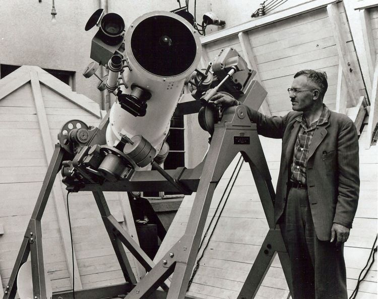 Clyde Tombaugh Stands With White Telescope