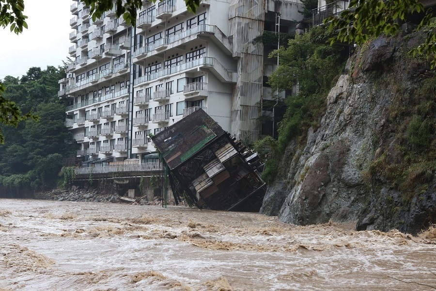 Building Topples Flood Japan