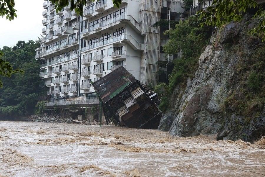 Building Topples Flood Japan