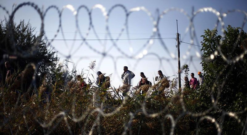 Syrian Refugees Arrive Hungarian Fence