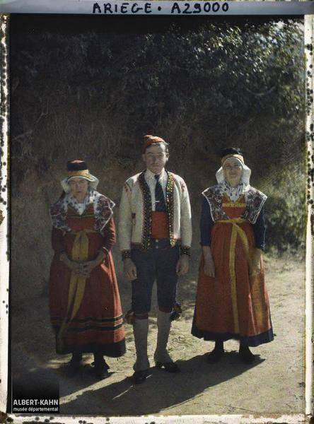 Three People In Traditional Dress