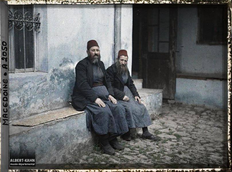 Two Men Sitting Down