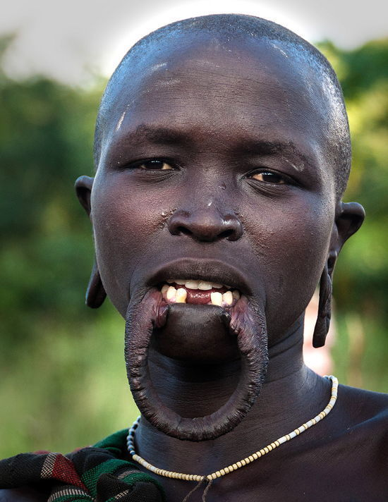 Mursi Lip Stretching