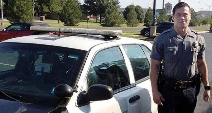 Daniel Holtzclaw With Patrol Car