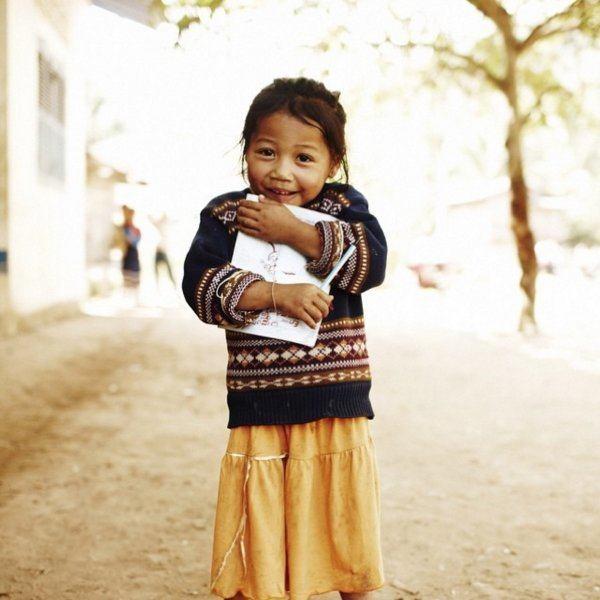 Little Girl Clutching Book