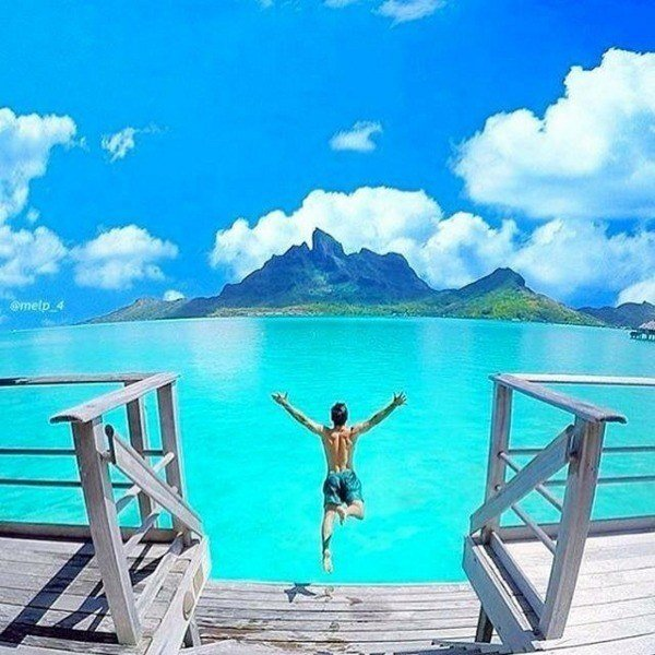 Man Jumping Into Tropical Ocean