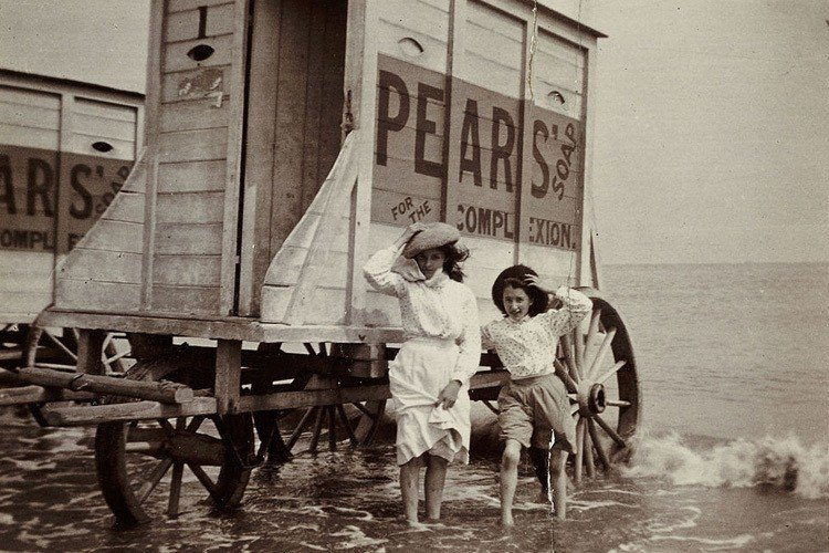 Girls Paddling Beside Bathing Machines, C 1900.