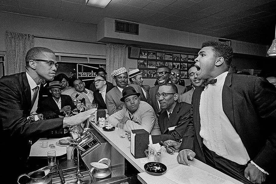 Photos Of Malcolm X's Iconic Friendship With Muhammad Ali