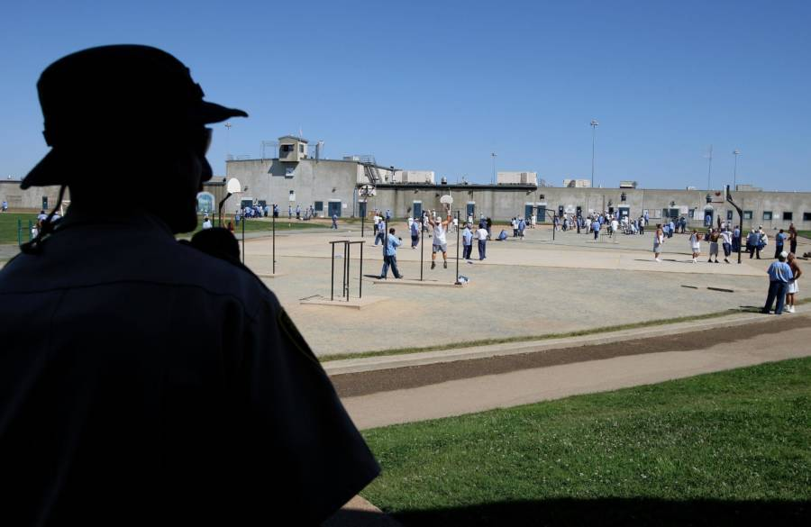 Guard Watching Prisoners