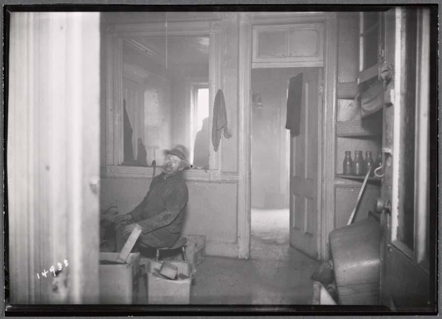 Man In Kitchen Tenement Building