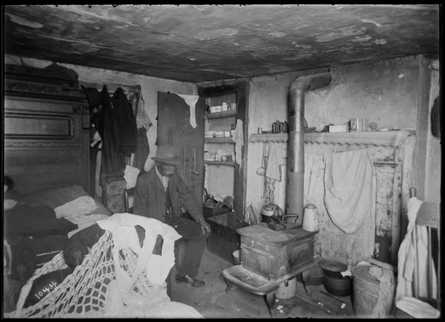 Man On Bed Tenement Building