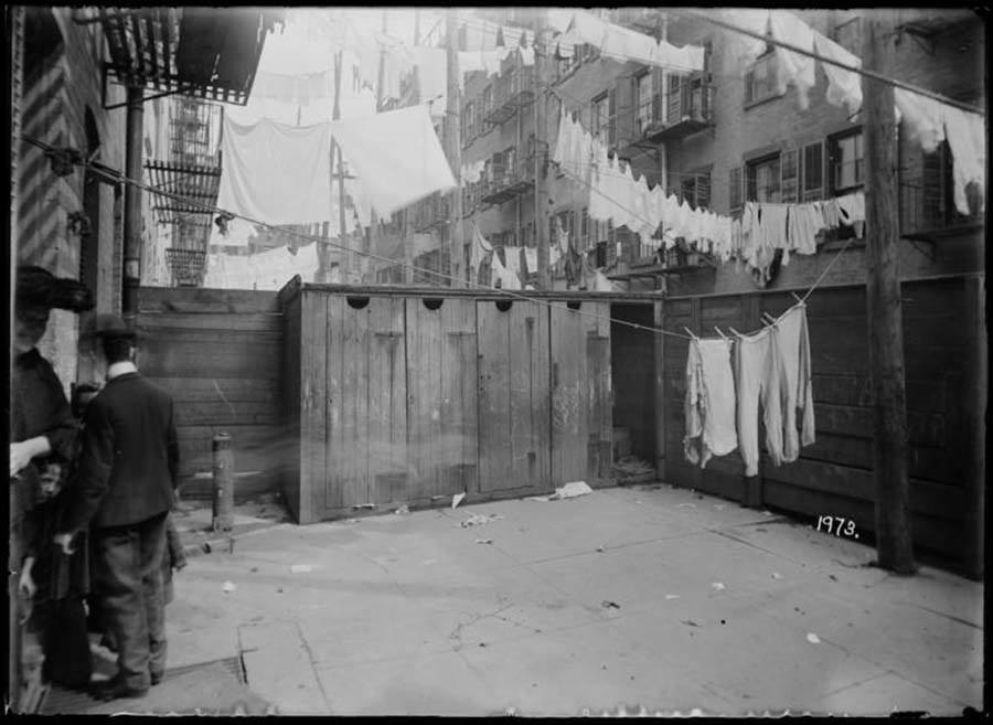 Three People Backyard Tenement Building