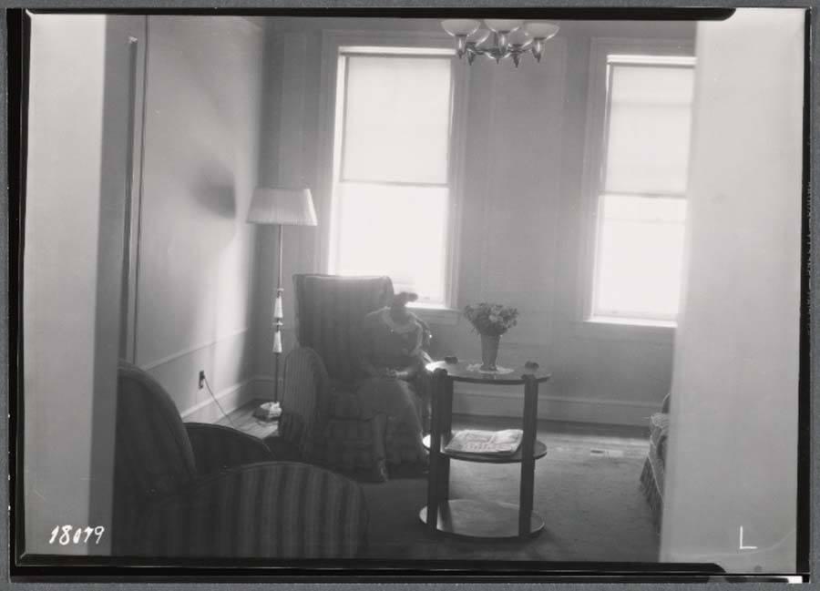 Woman In Living Room Tenement Building