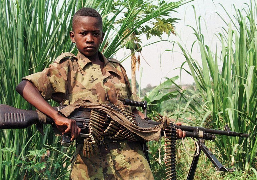 A Young Rebel Soldier With His Machine Gun Poses