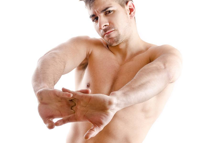 Shirtless Man Cracking Knuckles