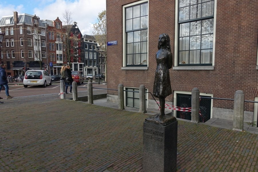 Statue Among City
