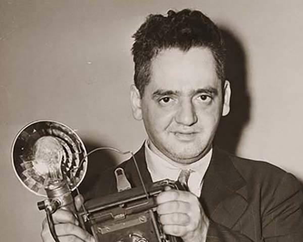 Weegee Holding Camera