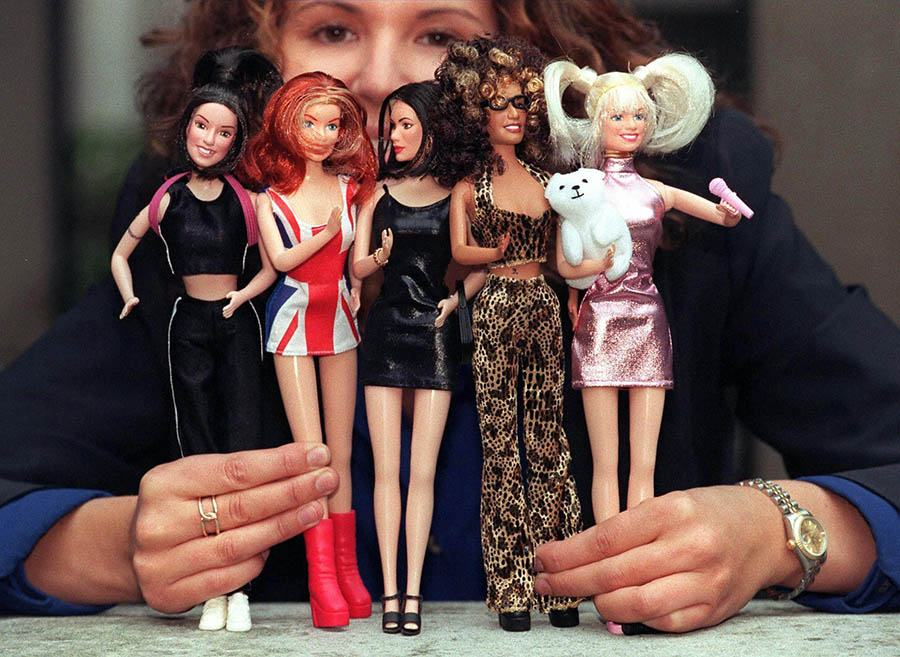 A Young Girl Holds The Spice Girls Dolls Which Wer