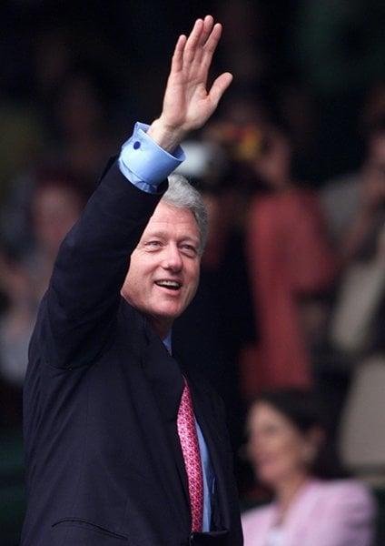 Bill Clinton Arms Raised